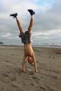 Beach handstand teenage boy doing a on a sandy Royalty Free Stock Photos