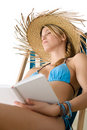 Beach - Happy young woman relax with book Stock Photo