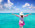 Beach hat woman rear view in Formentera Royalty Free Stock Photo