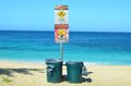 Beach hazard signs and dustbins Stock Photography