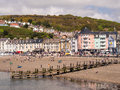 Beach holiday resort in wales uk the and holidaymakers at the seaside of aberystwyth ceredigion Royalty Free Stock Image