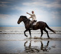 Beach horse rider pointing Stock Photo
