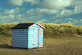 Beach hut in the sand dunes. Royalty Free Stock Photo