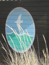 Beach hut seagull painting on a windy day Royalty Free Stock Image