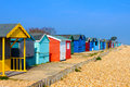 Beach huts brightly coloured at seaside Stock Image