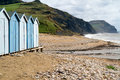 Beach huts on Charmouth beach in Dorset Royalty Free Stock Photo