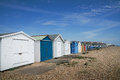 Beach huts multi coloured on cobbled south coast uk Royalty Free Stock Photos