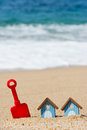 Beach huts and toys miniature with red plastic shovel Stock Photography