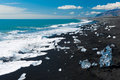 Beach with icebergs beautiful in the south of iceland a black lava sand is full of from glaciers not far away Stock Photo