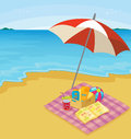 Beach illustration of a blanket of items at the Stock Images