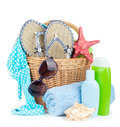 Beach items in basket isolated on white background Royalty Free Stock Photos