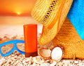 Beach items on sunset closeup the stony seashore hygiene accessories snorkeling mask sunscreen hat bag and towel summer Royalty Free Stock Photography