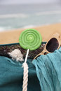 Beach items and waves sea blue straw bag with the shawl sunglasses Stock Images