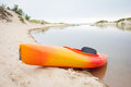 Beach kayak on near dunes Stock Images