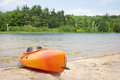 Beach kayak near woods on lake Royalty Free Stock Image