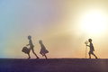 Beach kids playing at sunset at sea silhouettes of on the Royalty Free Stock Images