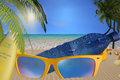 Beach with large sunglasses and big bottle water with suncream Royalty Free Stock Photo