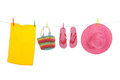 Beach laundry line with hanging flip flops and pink straw summer hat Royalty Free Stock Images