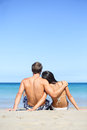 Beach lifestyle couple in love on vacation happy young interracial embracing and hugging enjoying ocean sea view and summer Royalty Free Stock Photo