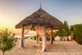 Beach lounge chairs at sunset zanzibar tanzania the shore of indian ocean Stock Images