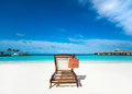 Beach lounger on sand beach maldives Stock Photography