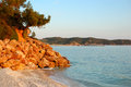 Beach at the luxury hotel during sunset thassos island greece Stock Photos