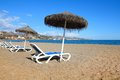 Beach in malaga andalusia region of spain suntanning chairs on a sandy Royalty Free Stock Photography