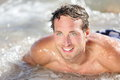 Beach man having fun water smiling happy portrait young handsome male beach model surfing bodyboard Stock Image