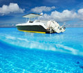 Beach and motor boat beautiful with white sand bottom underwater above water split view Stock Photo