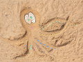 Beach octopus on sand background stock photo picture from made from colorful painted pebbles Stock Photos