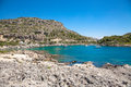 Beach off the coast of the island of Rhodes in Greece. Seaside l Royalty Free Stock Photo