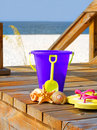 Beach pail on boardwalk Royalty Free Stock Photo