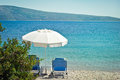 Beach parasol sunloungers and a on a in greece Royalty Free Stock Photography