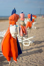Beach parasols at end of the day a sunny Royalty Free Stock Photo