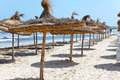 Beach with parasols from palm leaf on Mediterranean Stock Photo