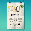 Beach party poster with palm leaf and lettering on wood texture