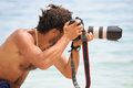 Beach photographer a professional is shooting at the the face is hidden Stock Photography