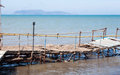 Beach pier old in the out of season with islands view mediterranean sea Stock Images