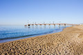 Beach Pier and Sea in Marbella Stock Images