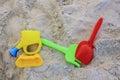 Beach plastic toys over sandy Stock Photography