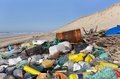 Beach pollution garbages plastic and wastes on the Royalty Free Stock Image