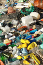 Beach pollution garbages plastic and wastes on the Stock Photo