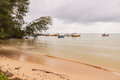 Beach on rainy season with some local fishing boats before raini Royalty Free Stock Photo