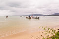 Beach on rainy season with some local fishing boats Royalty Free Stock Photo