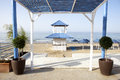 Beach refreshments stand wooden blue and white and pergola at beautiful white of south spain Stock Photos