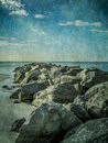 Beach rocks with textured overlay Royalty Free Stock Photography