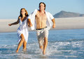 Beach run splash couple Stock Image