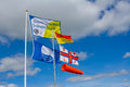 Beach safety flags including blue flag award rlni and no inflatables Stock Image