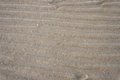 Beach sand background whit ripples from water Stock Photo