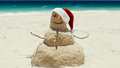 A beach sand man sculpture wishes a Merry Christmas Royalty Free Stock Photo